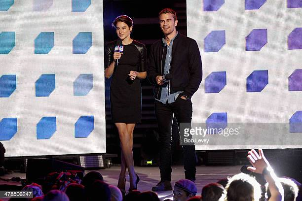 Actors Shailene Woodley and Theo James speak onstage at the 2014 mtvU Woodie Awards and Festival on March 13 2014 in Austin Texas