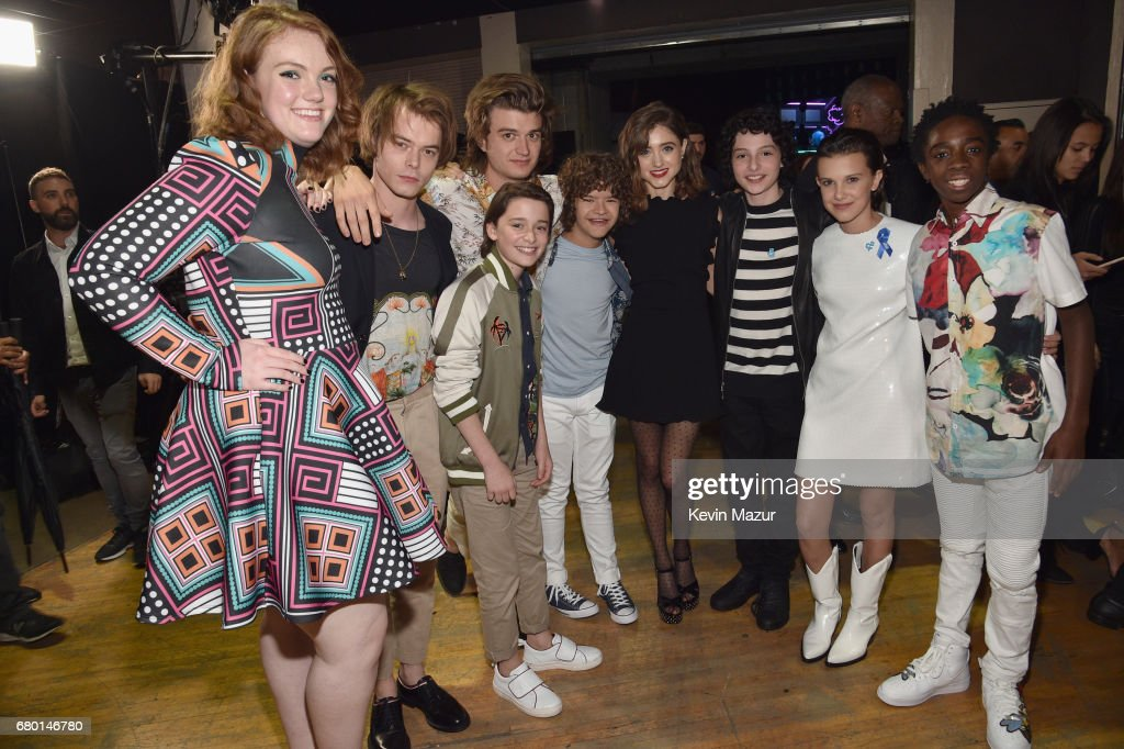 Actors Shannon Purser, Charlie Heaton, Noah Schnapp, Joe Keery, Gaten Matarazzo, Natalia Dyer, Finn Wolfhard, Millie Bobby Brown, and Caleb McLaughlin attend the 2017 MTV Movie And TV Awards at The Shrine Auditorium on May 7, 2017 in Los Angeles, California.