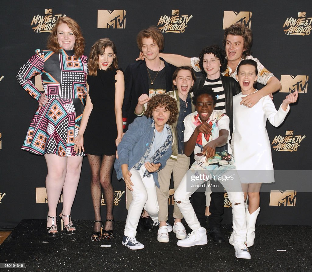 Actors Shannon Purser, Natalia Dyer, Charlie Heaton, Gaten Matarazzo, Caleb McLaughlin, Noah Schnapp, Finn Wolfhard, Joe Keery and Millie Bobby Brown of 'Stranger Things' pose in the press room at the 2017 MTV Movie and TV Awards at The Shrine Auditorium on May 7, 2017 in Los Angeles, California.