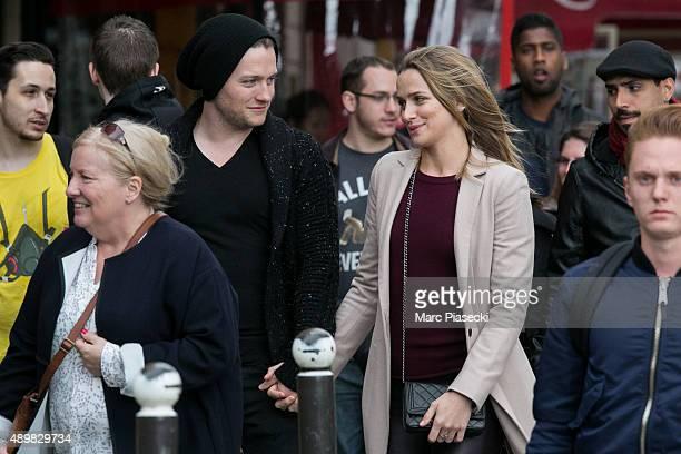 Actors Shantel Vansanten and Jon Fletcher are seen near the 'NotreDamedeParis' cathedral on September 24 2015 in Paris France