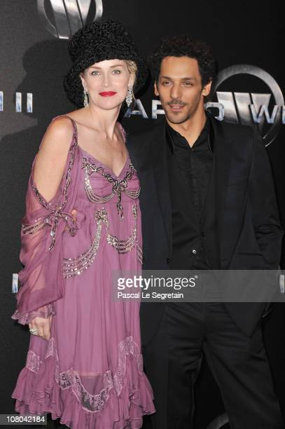 Actors Sharon Stone and Tomer Sisley attend the Paris Premiere for 'Largo Winch II' at Cinema Gaumont Opera on January 14 2011 in Paris France