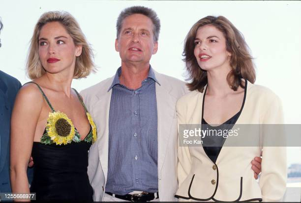 """Actors Sharon Stone, Michael Douglas and Jeanne Tripplehorn for """"Basic Instinct"""" attend the 45th Cannes film Festival on May 1992 in Cannes, France."""
