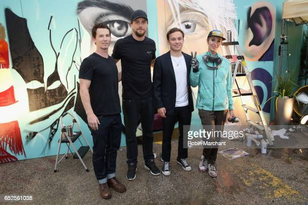 Actors Shawn Hatosy Ben Robson and Finn Cole pose for a photo with a staff member during TNT Animal Kingdom at SXSW 2017 on March 11 2017 in Austin...