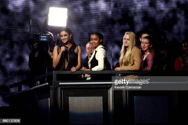 Actors Shay Mitchell and Yara Shahidi speak onstage during the 2017 MTV Movie And TV Awards at The Shrine Auditorium on May 7 2017 in Los Angeles...