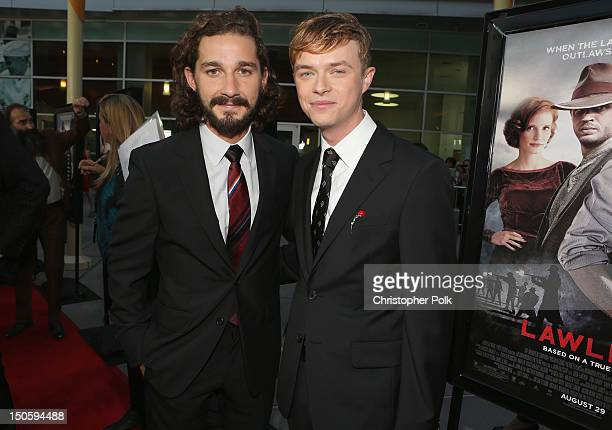 Actors Shia LaBeouf and Dane DeHaan arrive at the premiere of The Weinstein Company's Lawless held at ArcLight Cinemas on August 22 2012 in Hollywood...