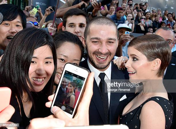 Actors Shia LaBeouf and Kate Mara take photos with fans at the 'Man Down' premiere during the 2015 Toronto International Film Festival at Roy Thomson...