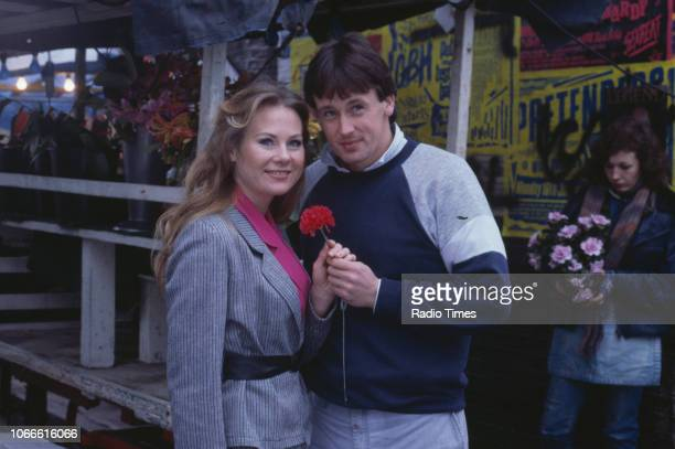 Actors Shirley Cheriton and Ross Davidson pictured on the set of the BBC soap opera 'EastEnders' circa 1986