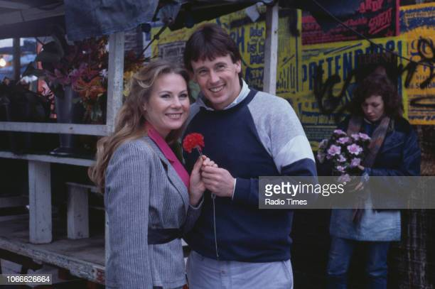 Actors Shirley Cheriton Ross Davidson and Jane Slaughter pictured on the set of the BBC soap opera 'EastEnders' December 30th 1984