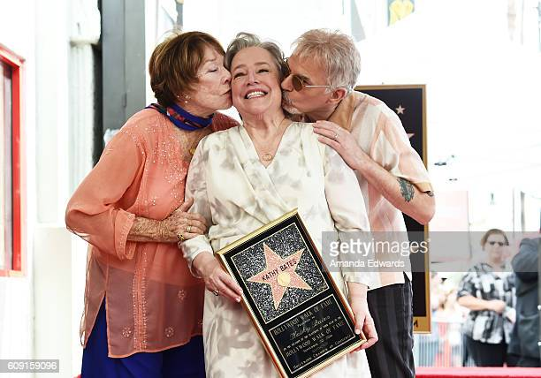 Actors Shirley MacLaine and Billy Bob Thornton kiss actress Kathy Bates as she is honored with a Star on the Hollywood Walk of Fame on September 20...