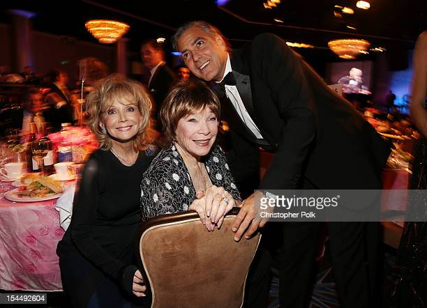 Actors Shirley MacLaine and George Clooney with guest attend the 26th Anniversary Carousel Of Hope Ball presented by MercedesBenz at The Beverly...