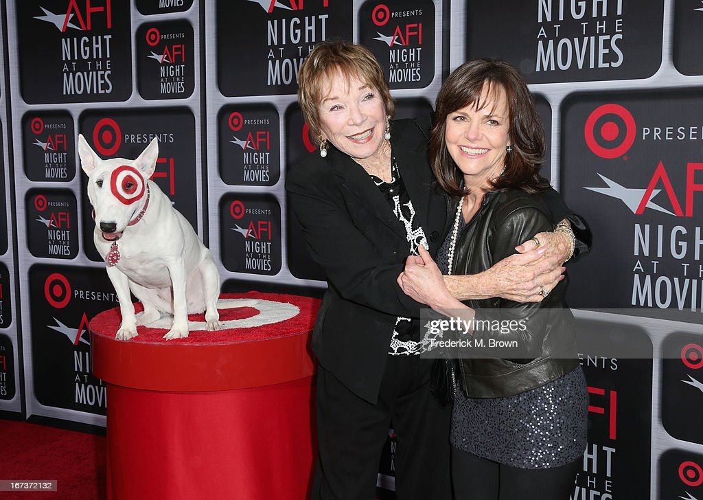 Actors Shirley MacLaine (C) and Sally Field (R) and Bullseye arrive on the red carpet for Target Presents AFI's Night at the Movies at ArcLight Cinemas on April 24, 2013 in Hollywood, California.