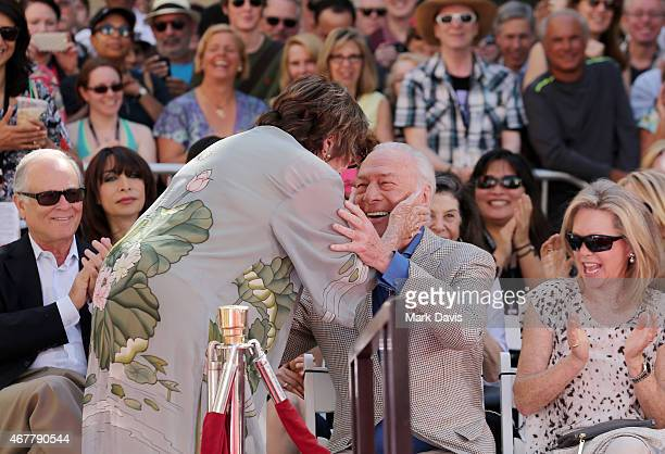 Actors Shirley MacLaine Christopher Plummer and Elaine Taylor attend the Christopher Plummer Hand and Footprint Ceremony during the 2015 TCM Classic...