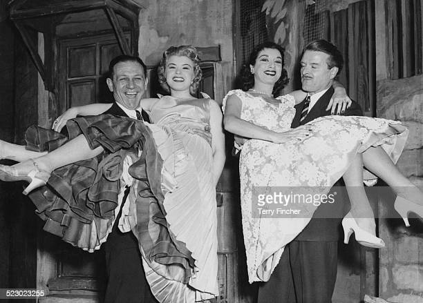 Actors Sid James and Dennis Bowen holding actresses Shani Wallace and Pat Kirkwood respectively during rehearsals for the London production of...