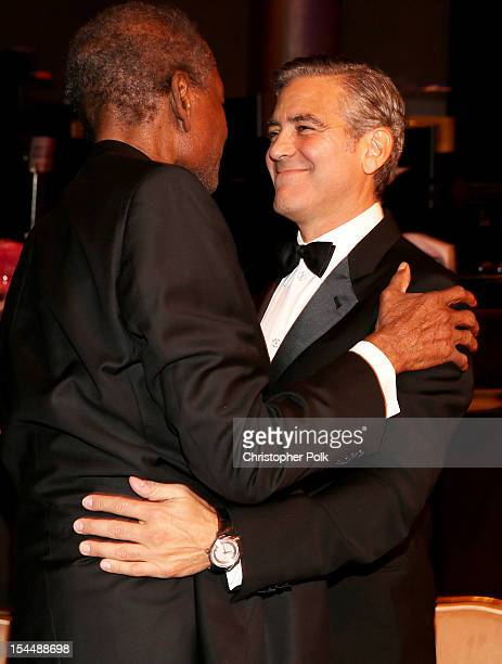 Actors Sidney Poitier and George Clooney speak during the 26th Anniversary Carousel Of Hope Ball presented by MercedesBenz at The Beverly Hilton...