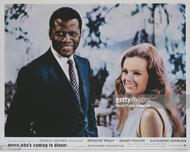 Actors Sidney Poitier and Katharine Houghton appear on the poster for the Columbia Pictures film 'Guess Who's Coming To Dinner' 1967