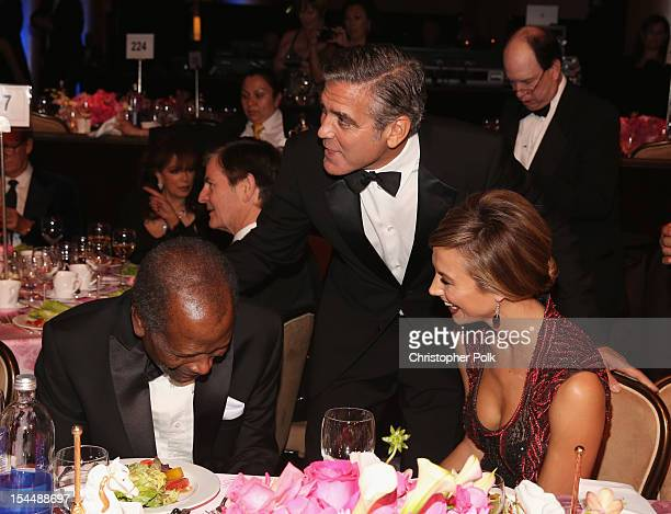 Actors Sidney Poitier George Clooney and Stacy Keibler speak during the 26th Anniversary Carousel Of Hope Ball presented by MercedesBenz at The...
