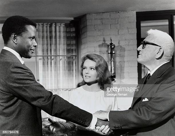 Actors Sidney Poitier Katharine Houghton and Spencer Tracy in a scene from the 1967 film Guess Who's Coming to Dinner directed by Stanley Kramer