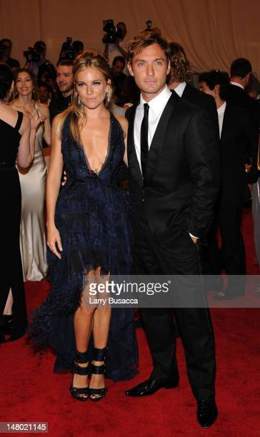 Actors Sienna Miller and Jude Law attend the Costume Institute Gala Benefit to celebrate the opening of the American Woman Fashioning a National...