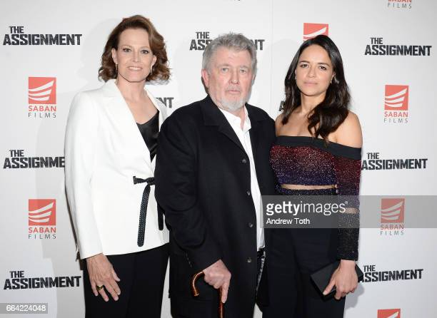 Actors Sigourney Weaver and Michelle Rodriguez pose with Director Walter Hill at 'The Assignment' screening at the Whitby Hotel on April 3 2017 in...