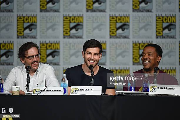 Actors Silas Weir Mitchell David Giuntoli and Russell Hornsby attend the Grimm season five panel during ComicCon International 2015 at the San Diego...