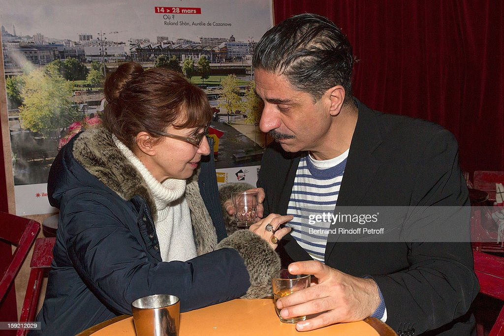 Actors Simon Abkarian (R) and Ariane Ascaride share a drink after Abkarian performed on stage during the premiere of 'Menelas rebetiko rapsodie' he wrote and directed, at Le Grand Parquet on January 9, 2013 in Paris, France.