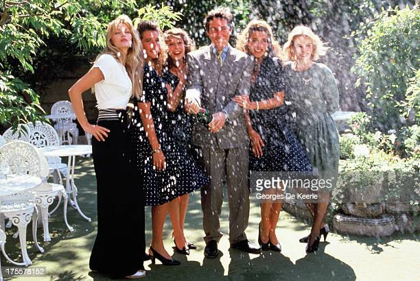 Actors Simon Dutton Arielle Dombasle and twin sisters Sabine and Camille Naud pose in a shoot for the TV movie 'The Saint' as they spray champagne on...