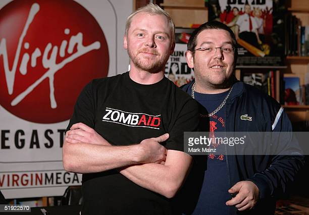 Actors Simon Pegg and Nick Frost sign copies of the DVD Shaun of the Dead at the Virgin Megastore on January 6 2005 in Hollywood California