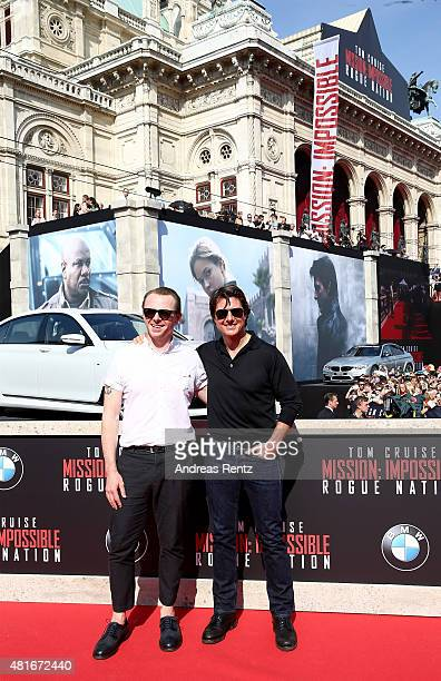 Actors Simon Pegg and Tom Cruise arrive for the world premiere of 'Mission Impossible Rogue Nation' at the Opera House on July 23 2015 in Vienna...