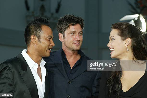 Actors Simon Yam Gerard Butler and Angelina Jolie attend the world premiere of the film Lara Croft Tomb Raider The Cradle of Life at Grauman's...