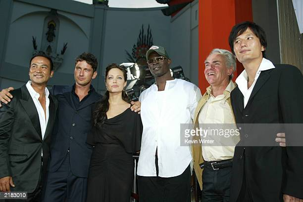 Actors Simon Yam Gerard Butler Angelina Jolie Djimon Hounsou director Jan De Bont and Terence Yin attend the world premiere of the film Lara Croft...