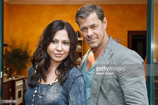 Actors Simone Thomalla as Sofie Becker and Sven Martinek as Vincent pose at the film set of 'Nach All Den Jahren' on July 6, 2011 in Leipzig, Germany.