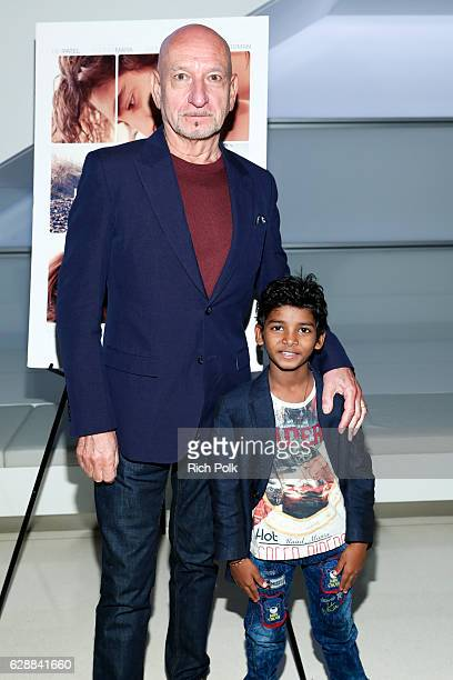 Actors Sir Ben Kingsley and Sunny Pawar pose for a photo at an event where Sir Ben Kingsley hosts a special LION screening at CAA with young actor...