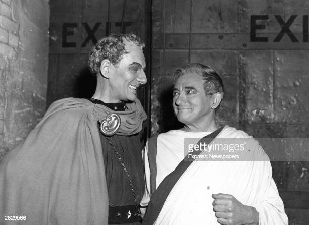 Actors Sir John Gielgud and Claude Rains in Roman togas sharing a joke during rehearsals Original Publication People Disc HF0542