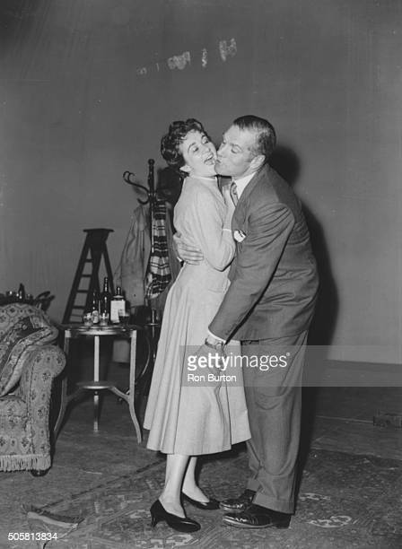 Actors Sir Laurence Olivier and Joan Plowright embracing as they rehearse a scene from the play 'The Entertainer', September 1957.