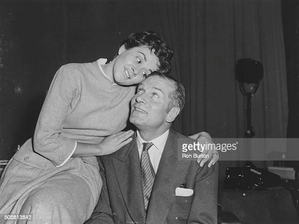 Actors Sir Laurence Olivier and Joan Plowright embracing as they rehearse a scene from the play 'The Entertainer', 1957.