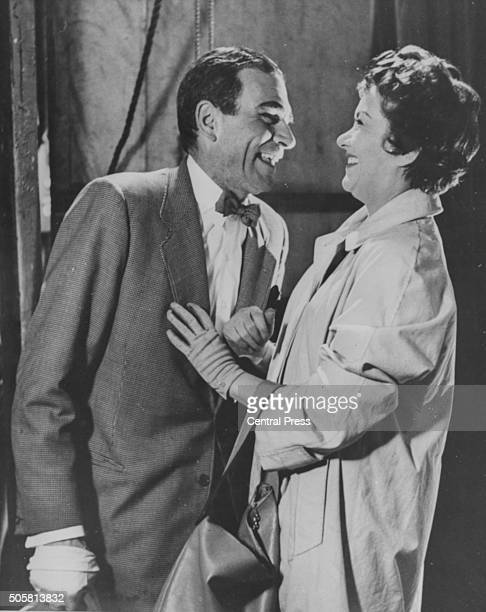 Actors Sir Laurence Olivier and Joan Plowright laughing together in a scene from the film 'The Entertainer', September 15th 1960.