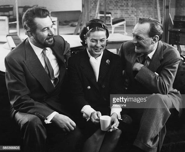 Actors Sir Michael Redgrave Ingrid Bergman and Trevor Howard chatting during a break in rehearsals for the BBC television play 'Hedda Gabler' London...