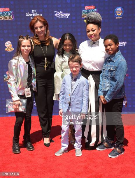 Actors Sky Katz Anneliese van der Pol Navia Ziraili Robinson Jason Maybaum RavenSymone and Issac Ryan Brown attend the 2017 Radio Disney Music Awards...