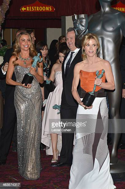 Actors Sofía Vergara Sarah Hyland Eric Stonestreet and Julie Bowen pose outside the press room during the 20th Annual Screen Actors Guild Awards at...