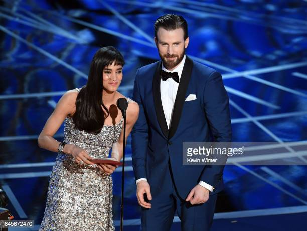 Actors Sofia Boutella and Chris Evans speak onstage during the 89th Annual Academy Awards at Hollywood Highland Center on February 26 2017 in...