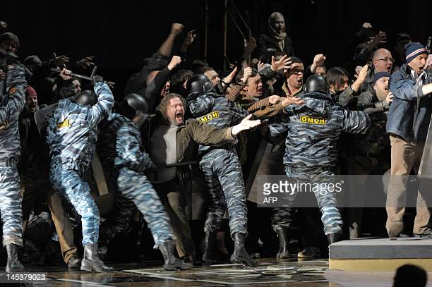 Actors some of them wearing uniforms of presentday Russia's or OMON riot police take part in anew production of 'Boris Godunov' by Modest Mussorgsky...