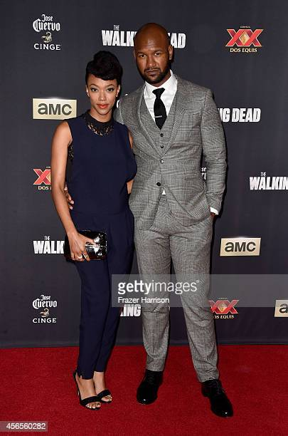 """Actors Sonequa Martin-Green and Kenric Green attend the season 5 premiere of """"The Walking Dead"""" at AMC Universal City Walk on October 2, 2014 in..."""