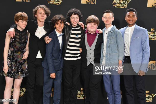 Actors Sophia Lillis Wyatt Oleff Jack Dylan Grazer Finn Wolfhard Jeremy Ray Taylor Jaeden Lieberher and Chosen Jacobs pose in the press room at the...