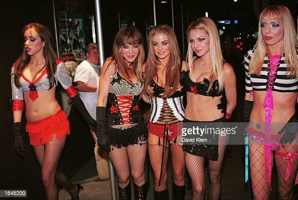 Actors Staci Flood Carmet Bechar Carmen Electra Cyia Batten and Kasey Campbell pose after a performance of the dance show 'Pussycat Dolls Live' May...