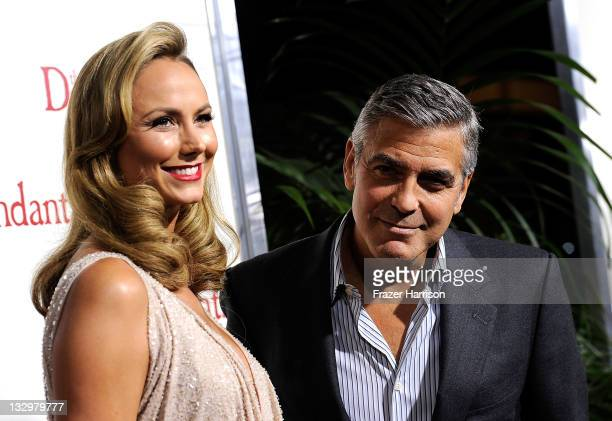 Actors Stacy Keibler and George Clooney arrive at the Premiere Of Fox Searchlight's The Descendants at AMPAS Samuel Goldwyn Theater on November 15...