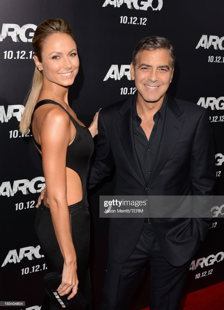 Actors Stacy Keibler and George Clooney arrive at the premiere of Warner Bros. Pictures' 'Argo' at AMPAS Samuel Goldwyn Theater on October 4, 2012 in Beverly Hills, California.