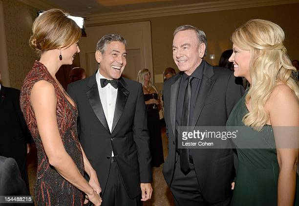 Actors Stacy Keibler and George Clooney singer Neil Diamond and wife Katie McNeil attend the 26th Anniversary Carousel Of Hope Ball presented by...