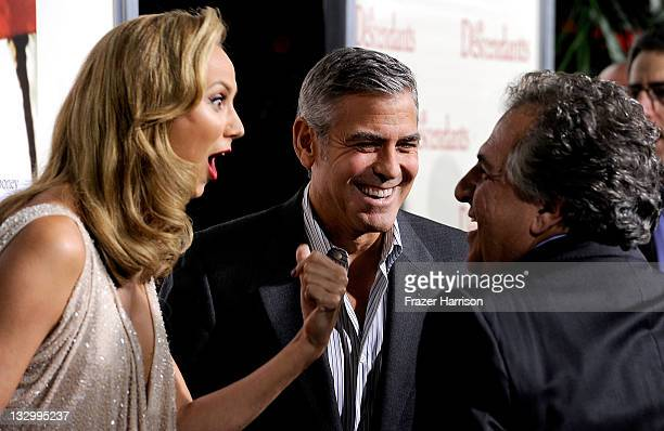 Actors Stacy Keibler and George Clooney speak with Fox's Filmed Entertainment cochairman and CEO Jim Gianopulos at the Premiere Of Fox Searchlight's...