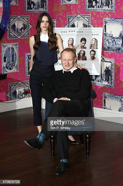 Actors Stacy Martin and Stellan Skarsgard attend a photocall for 'Nymphomaniac' at Soho Hotel on February 21 2014 in London England