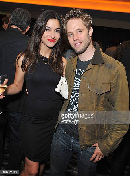 Actors Stephanie Fantauzzi and Shaun Sipos attend the US launch of 'Planet Ocean' presented by Omega Watches at Pacific Design Center on April 18...